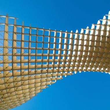 a shot from underneath funky architecture found in Sevilla, Spain