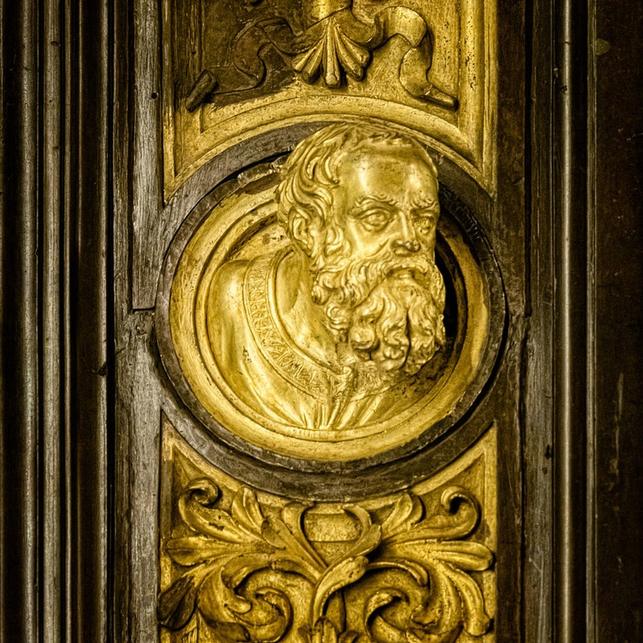 A close-up detail from one of the original doors of the Baptesterium as they are preserved in the Duomo Museum
