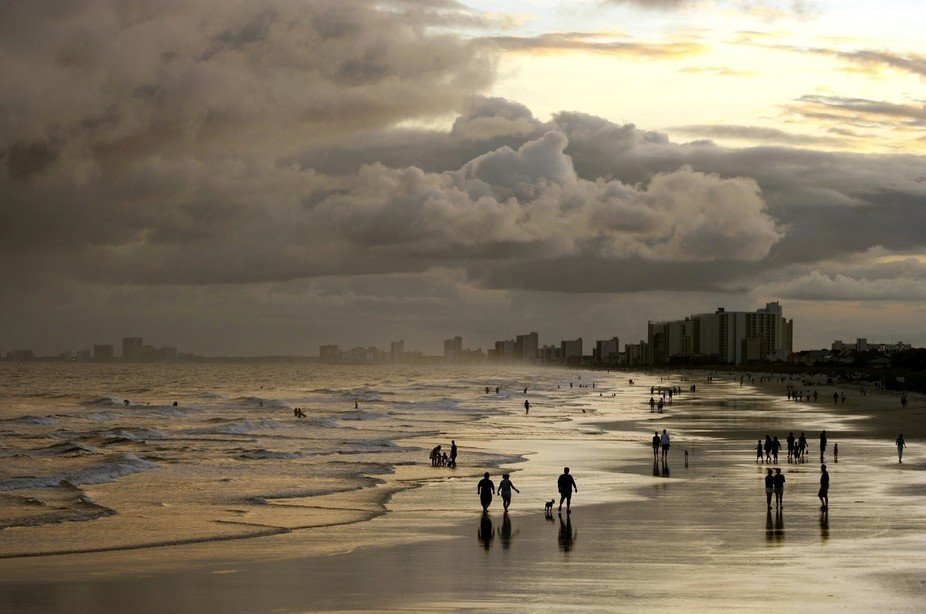 Image captured the night before Katrina hit the LA coast, people walking on the beach oblivious t...