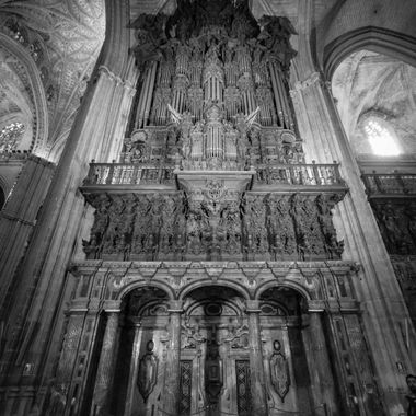 black and white shot taken inside the cathedral in Seville, Spain