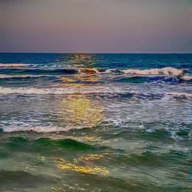 I took this photo when me and my wife were walking along the beach, towards the end of December, 2017. There  was a full moon and its light was shining on the waves. This was one of the photos I took that day.