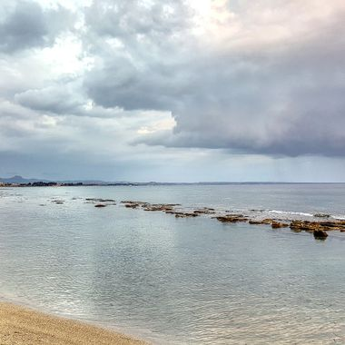 I took this photo when me and my wife were walking along the beach, in January 2018. It was a cloudy and rainy day, but we like walking in the rain. So, this was one of the photos I took that day.