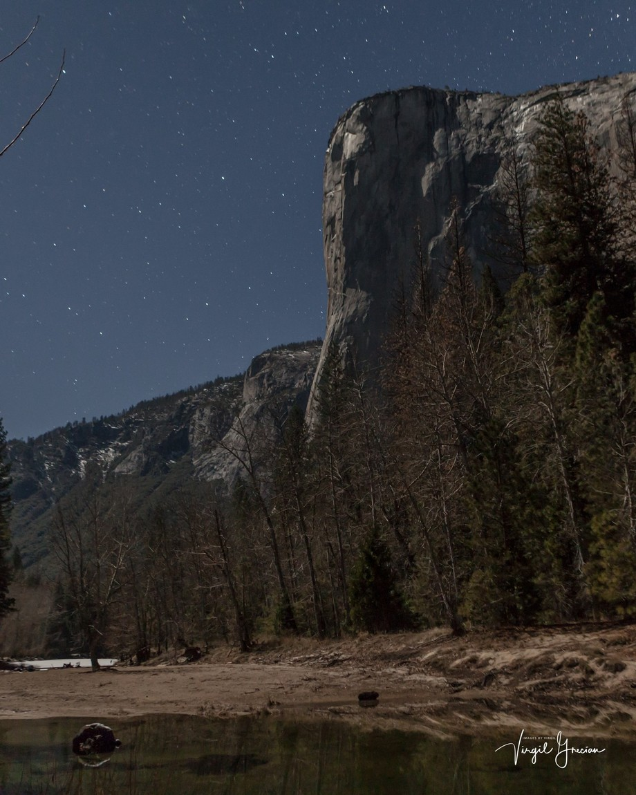 Yosemite is a great place to shoot, especially at night.  The half moon illumined the east face of El Cap nicely as the Merced River flows below the impending buttress.