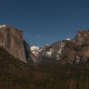 Another of the famous vantage points to see the Yosemite Valley is at Tunnel View.  Even at 1145 PM, the moon has clearly illumined the main features of this view, El Cap, Bridalveil Falls, Cathedral Rocks, and Half Dome in the background.  It is a place that captures the imagination, and holds it, until long after your fingers can work the controls on your camera.