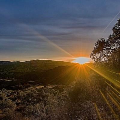 Sunrise cresting the carmel valley, ca hills