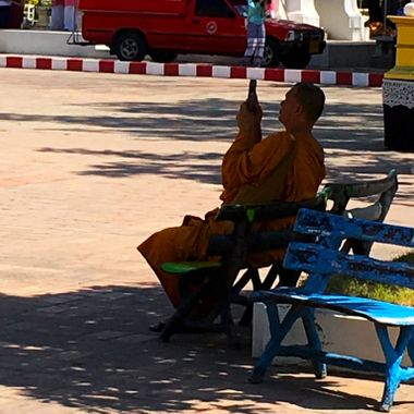 Buddhist monk getting his nirvana in the shade in Thailand