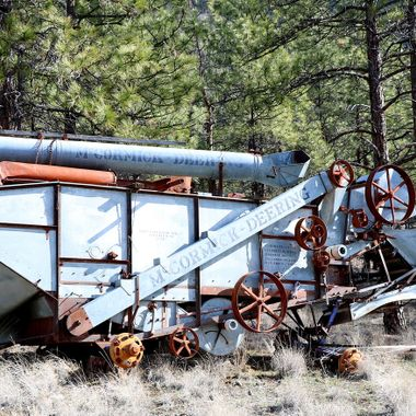 McCormic Deering Thrashing Machine lies abandoned along highway 12 in British Columbia