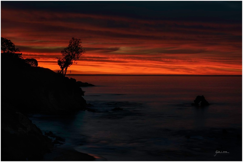 Taken on the cliffs above tide pools in Corona Del Mar at high tide with another beautiful sunrise.