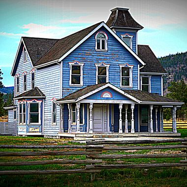 A enhancement of a shot of an old house on a local ranch