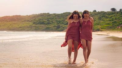 Twins beach stroll.