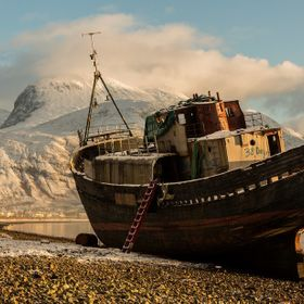 We were in Fort William after a foray into Glen Etive and this abandoned boat was on the beach. With Ben Nevis covered in snow and the tide out !...