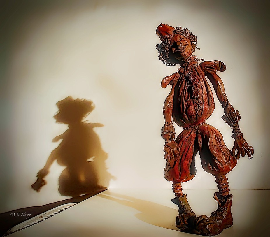 This is a bronze sculpture of the Scarecrow character played by Michael Jackson in the movie WIZ....