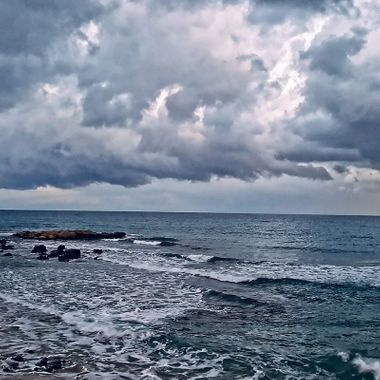 I took this photo when me and my wife were walking on the beach, at Iskele, Cyprus, in January 2018. It was a cloudy and rainy day.  We enjoy walking along the beach in all kinds of weather. This was one of the photos that I took that day.