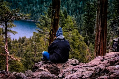 A Stranger Setting On The Edge Of Lake Tahoe's Waterfall . . .