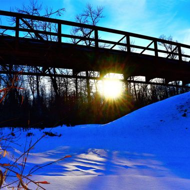 Remote snowmobile trail bridge over the Rat Root river at sunset. Nikon D3400 cropped and edited