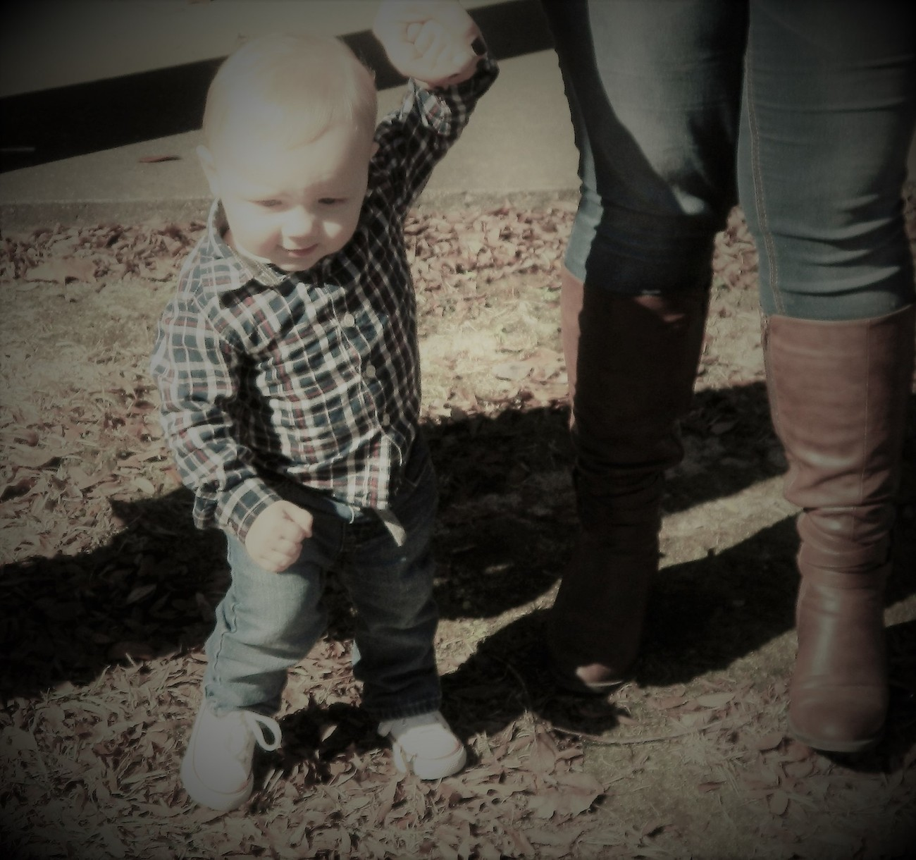 Micah's mom teaching him to walk at 10 months old.....and Micah teaching mom how to have fun again at the park.