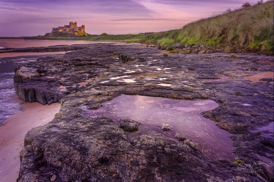 Bamburgh Castle at at sunset, Northumberland, England.
