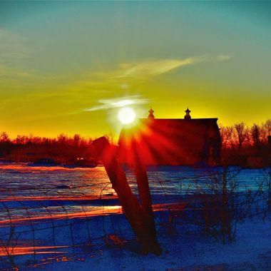 Old Roger's barn Feb. 3 sunset. Loved how the sun lit up the whole side of the roof and filtered through the doors in the front. Ice on the snow reflected the sunset between the drifts. Nikon D3400 supervivid & vignette