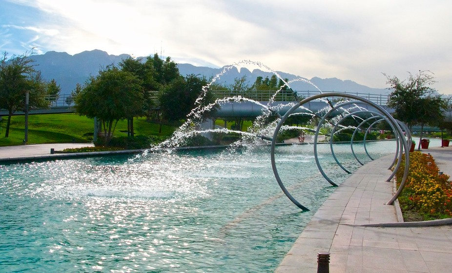 Fundidora Park, Monterrey, Mexico. Santa Lucia walk is surrounded of fountains, and lights inside...