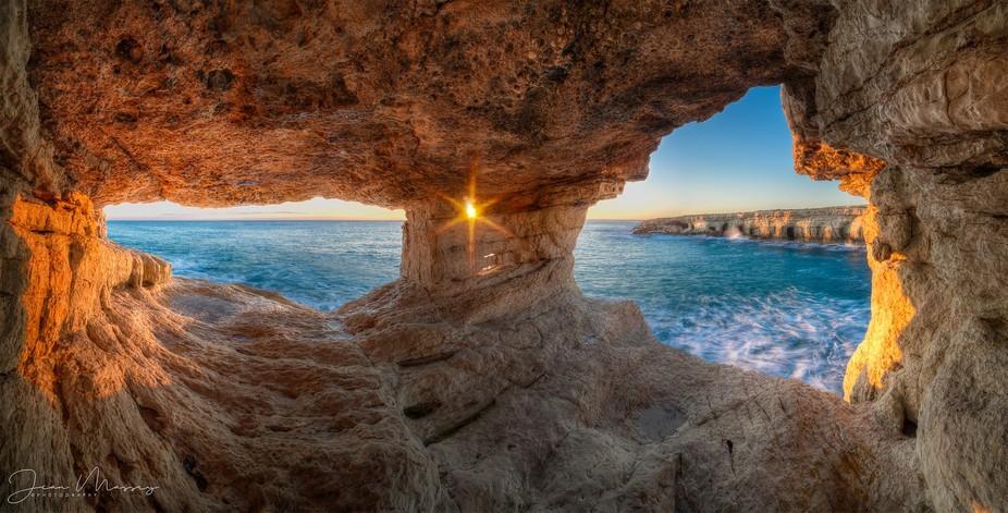 Sunset Peek, eyes of rocks windows peeking at Sun setting and Sun breaking through.