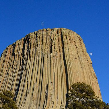 Moon peeking around Devils Tower.
