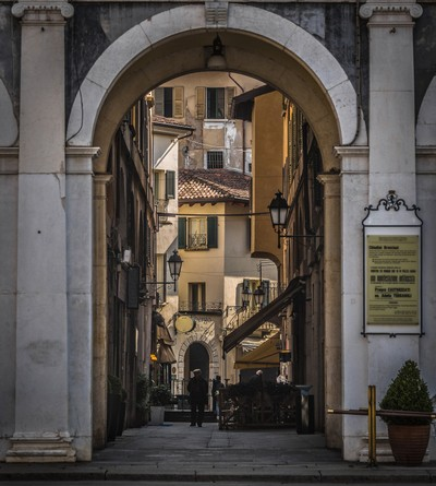 Old street in Brescia, view through the arch in the center