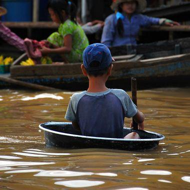 Young boy seeking fishing opportunities on Tonle Sap Lake, Cambodia!