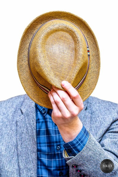 Gray jacket man covering his face with summer hat