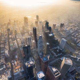 Hazy weather in Downtown Los Angeles from a helicopter near sunset.