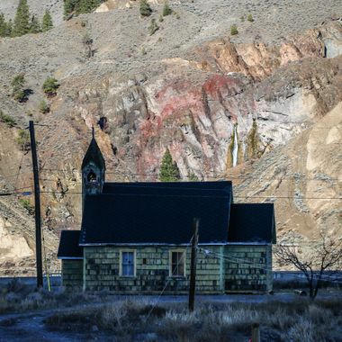 A little green church at Spences Bridge B C. Murray Creek falls can be seen in the background.