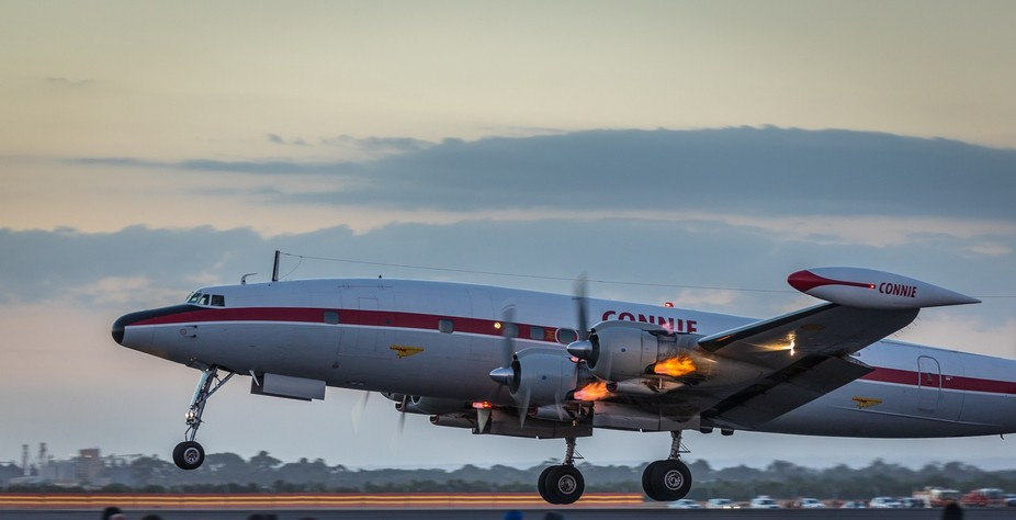HARS Lockheed C-121C Super Constellation taking off at dusk