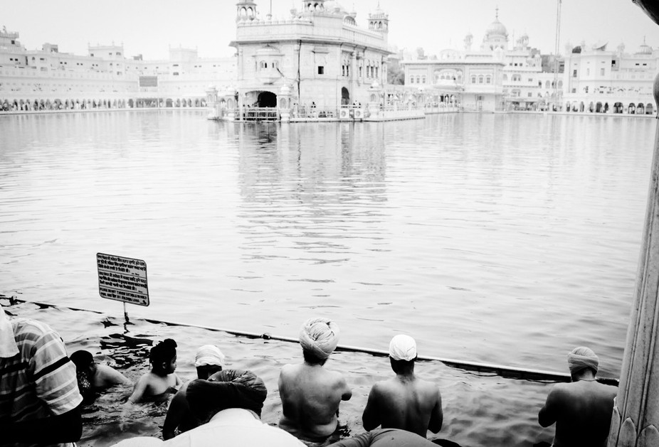 This iconic scene of devotees taking a dip in the holy Sarovar at Golden temple caught my eye dur...