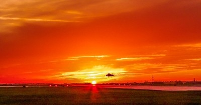 USAF F-15E Strike Eage lands in a magnificent sunset