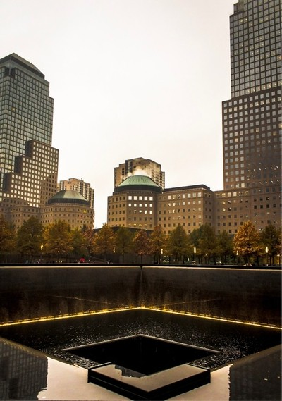The reflecting pools at the 9-11 memorial in New York City. These pools reflect not only the buildings that stand by, but the lives lost that day.