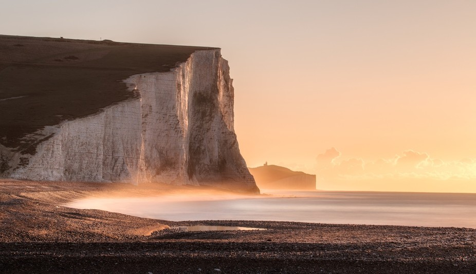 The Seven Sisters is a series of chalk cliffs by the English Channel. They form part of the South Downs in East Sussex, between the towns of Seaford and Eastbourne in southern England.