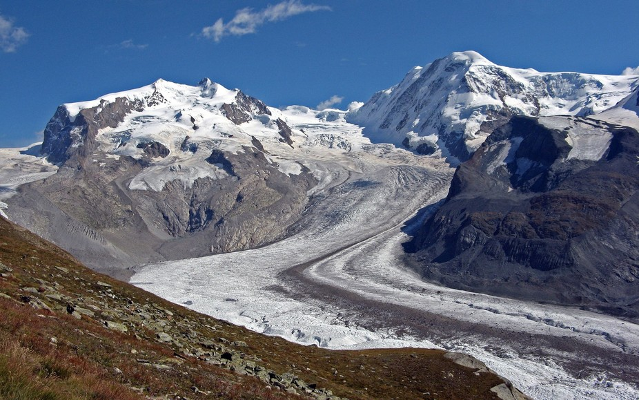 This photo was taken having traversed the Pointe Dufour, descended to the Gornergletscher and climbed back up to Riffelberg (a long day). The Pointe Dufour is the highest mountain in Switzerland and is the point just left of centre.