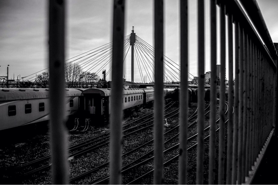 A view of Johannesburg's(South Africa) famous Mandela Bridge through a set of handrail bars dep...