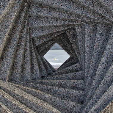 Looking through the opening in a stone carving.