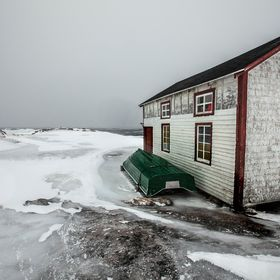 Picture of fishing boat and building taken in Blanc Sablon Quebec Canada. The southern coastal region is subject to severe winter weather and win...