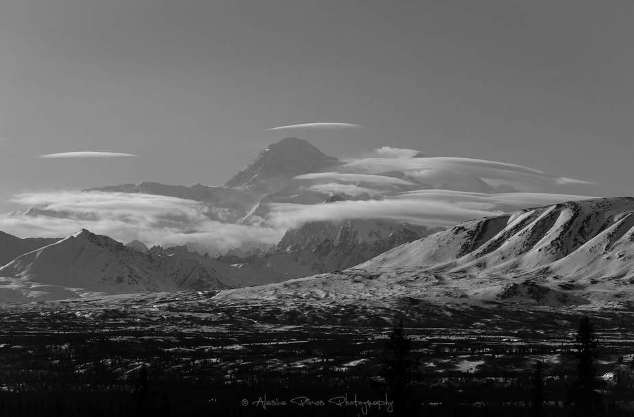 This is the backside of Denali, with low laying clouds.