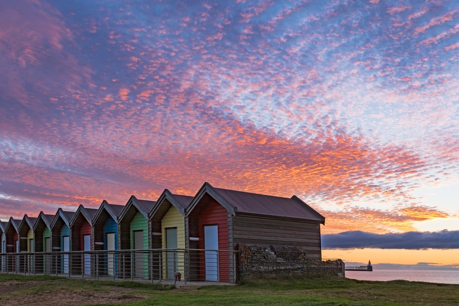 These beach huts are in Blyth, Northumberland, UK and often have an amazing sunrise as a backdrop.