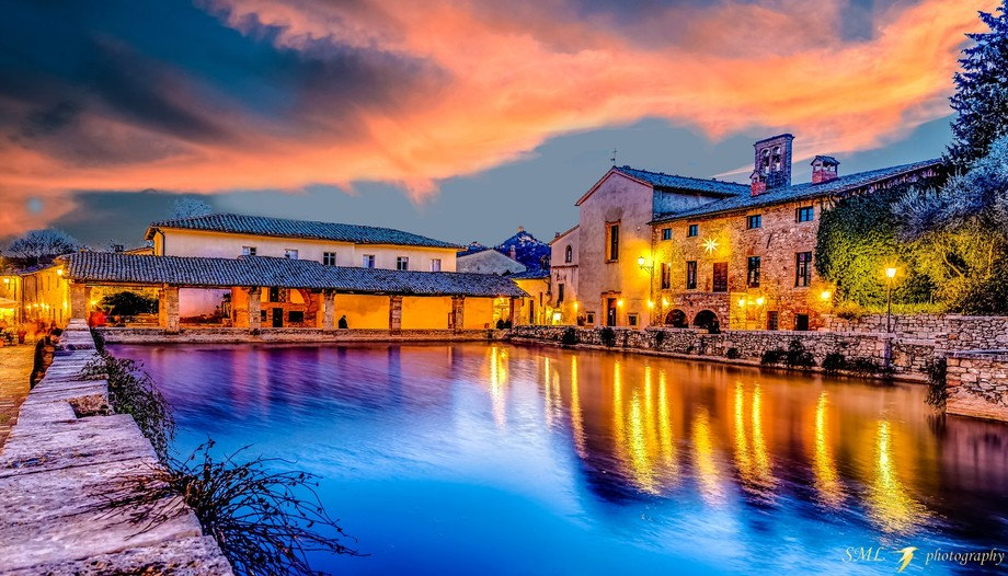 Bagno Vignoni is a lovely little village south of Siena. Its main square is replaced by a large p...