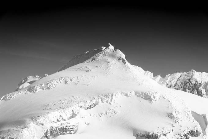 One of the peaks from the Garibaldi Provincial Park. After fresh snowfall captured this image on a bluebird day air was crisp and mountains were dressed in white!