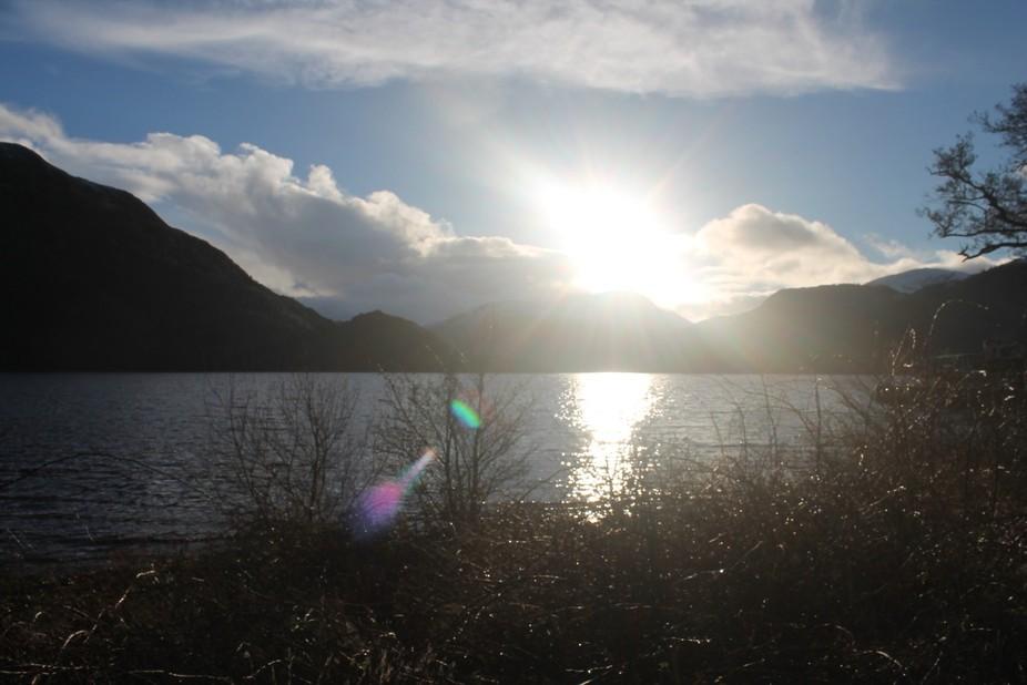Sun burst over ullswater in winter