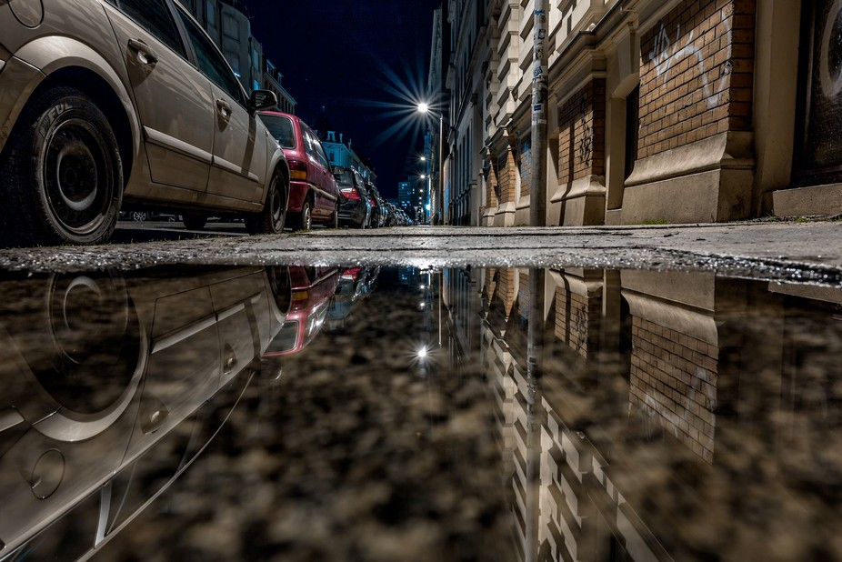 Just an ordinary German street with a puddle.