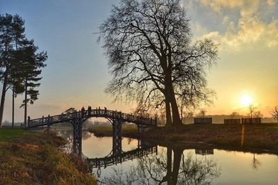 Sun setting over the Chineese bridge at Croome Court.