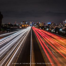 A Friday NIght commute on the freeway in San Diego looking towards the beautiful buildings of Downtown San Diego