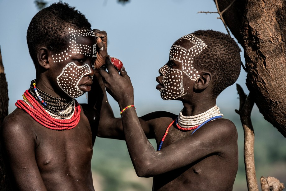 Girls from the Karo tribe in the Omo Valley of Ethiopia doing facing painting