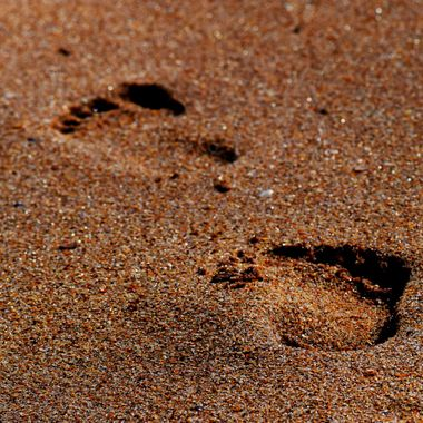 2 footprints in the sand