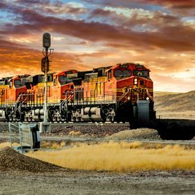 This is a freight train that with 3 engines in front and 2 behind climbed over the Rocky Mountains in Montana.